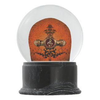 Golden clef on a awesome button snow globe