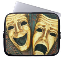 Golden comedy and tragedy masks on patterned computer sleeve