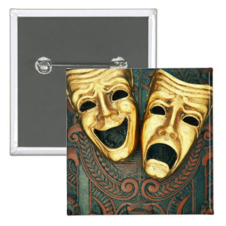 Golden comedy and tragedy masks on patterned pinback button