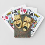Golden comedy and tragedy masks on patterned playing cards