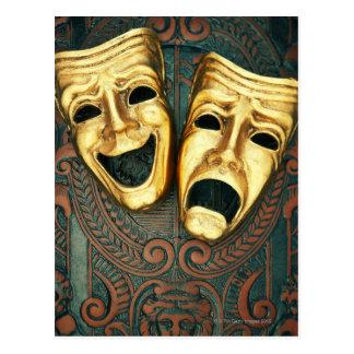 Golden comedy and tragedy masks on patterned postcard