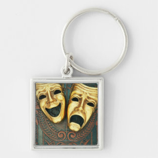 Golden comedy and tragedy masks on patterned Silver-Colored square keychain