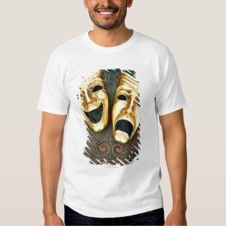 Golden comedy and tragedy masks on patterned tees