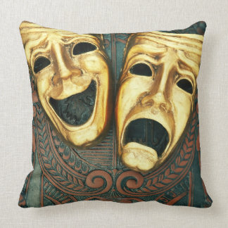 Golden comedy and tragedy masks on patterned throw pillow
