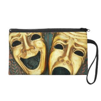 Golden comedy and tragedy masks on patterned wristlet purse
