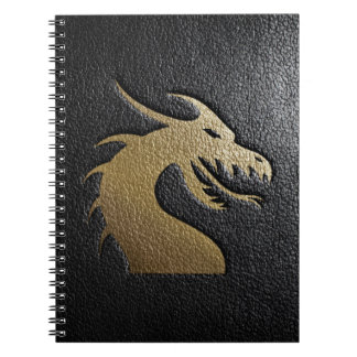 Golden dragon silhouette on black leather spiral notebook