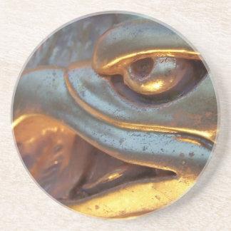 Golden eagle sculpture close up drink coaster