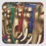 Golden elephants decorated with colorful square sticker
