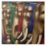 Golden elephants decorated with colorful tile