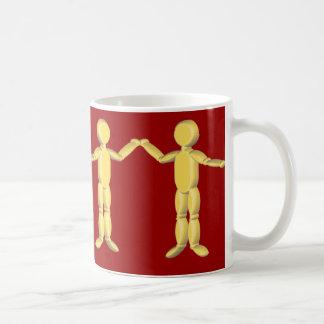 Golden figures in a row mug