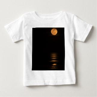 golden full moon over ocean baby T-Shirt