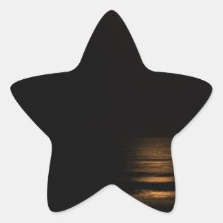 golden full moon over ocean star sticker