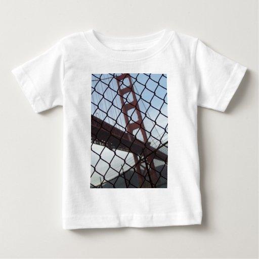 Golden Gate behind a fence T Shirts