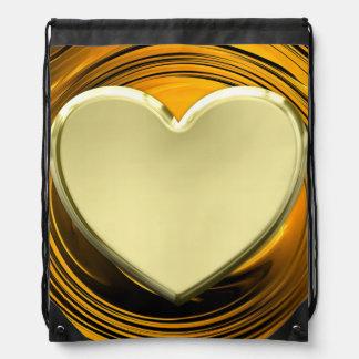 Golden heart on golden liquid background drawstring bag