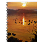 Golden lake sunset with geese notebook