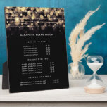 "Golden Lights | Pricing & Services Display Plaque<br><div class=""desc"">Elegant plaque with easel displays your services, price list or business information in white lettering on a crisp black background, crisscrossed at the top by golden string lights with a blurred bokeh effect. Includes three customizable headings and body text fields. To adjust layout, enter your text and then use the...</div>"