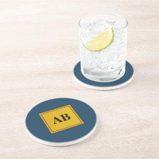 Golden monogram design drink coasters