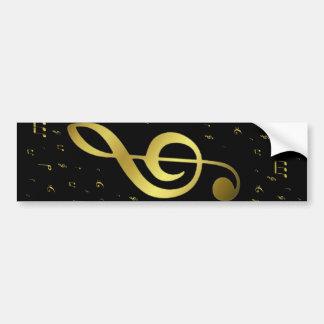 golden music notes in black bumper sticker