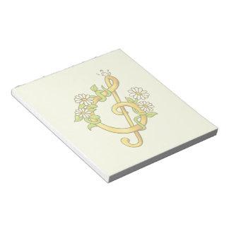 Golden musical note notepad