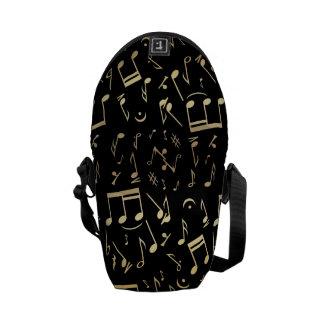 Golden musical notes on Black background Courier Bag