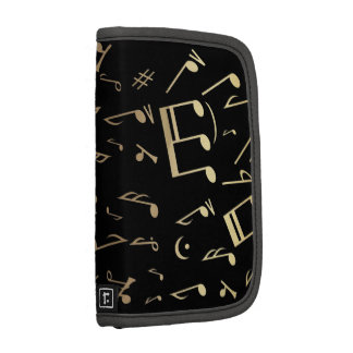 Golden musical notes on Black background Organizers