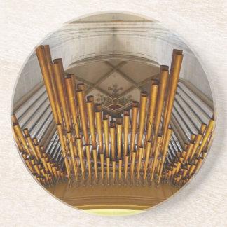 Golden organ pipes drink coaster