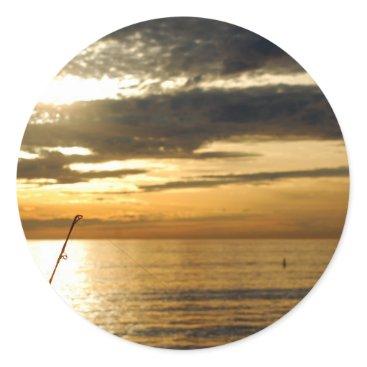 Beach Themed golden pacific sunset classic round sticker