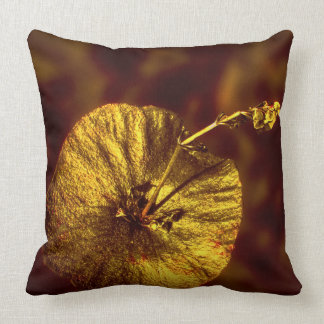 Golden plant on a cotton throw pillow