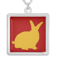 Golden Rabbit Silhouette on Red On Silver Necklace at Zazzle