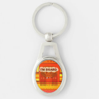 Golden red African traditional colors I'm board Silver-Colored Oval Metal Keychain