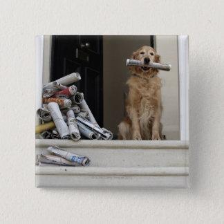 Golden retriever dog sitting at front door button