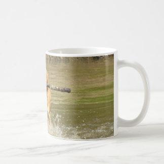 Golden retriever with stick coffee mug