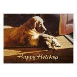 Golden retriever y tarjeta de Navidad del gato