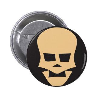 Golden skull button