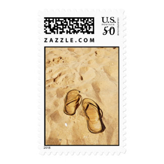 golden slippers on the beach postage