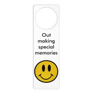 Golden smiley face door knob hangers
