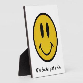 Golden smiley face plaque