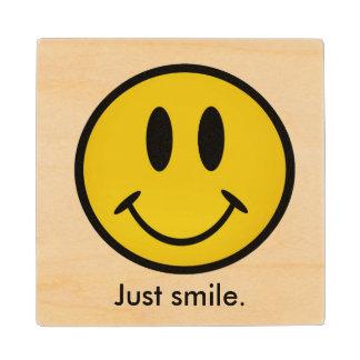 Golden smiley face wood coaster