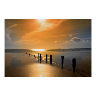 golden sunrise over the beach breakers poster