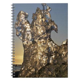 Golden sunrise seen through iceberg formation notebook