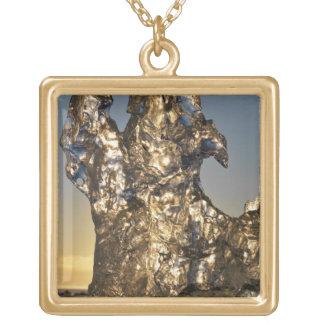 Golden sunrise seen through iceberg formation square pendant necklace