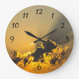 Golden Sunset Illuminating a Cloud Large Clock