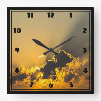 Golden Sunset Illuminating a Cloud Square Wall Clock