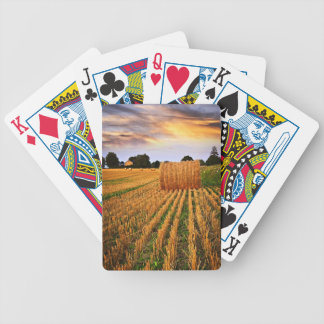 Golden sunset over farm field bicycle card deck