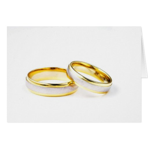 Golden Wedding Rings On White Background Greeting Cards