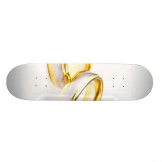 Golden Wedding Rings On White Background Skateboard Deck