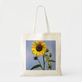 Goldfinch americano en el girasol bolsas de mano