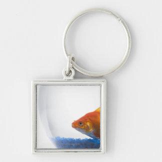 Goldfish in bowl on white background keychain