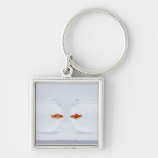 Goldfish in separate fishbowls looking face to fac keychain