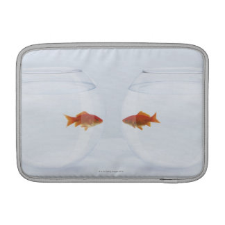 Goldfish in separate fishbowls looking face to fac sleeves for MacBook air